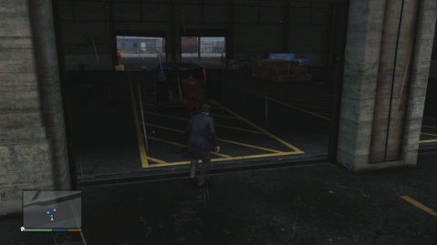 Sneak into the warehouse from behind.