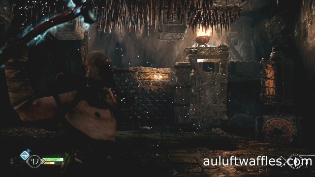 To escape the death trap throw the axe at the top right of the spike wall in The River Pass in God of War: Ascension.