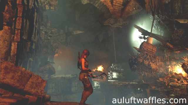 Use a rope arrow to pull the swinging weight towards the rubble on the bridge to complete the howling caves tomb in Kuwaq Yaku in Shadow of the Tomb Raider