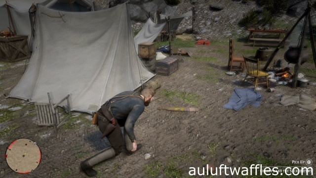 The sacred items are on the ground in front of a tent in Archaeology for Beginners for Rain Falls in Red Dead Redemption 2