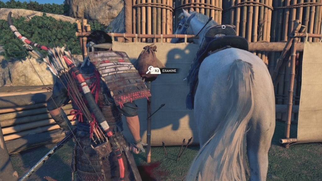 Examine the bag to inspect the target in The Sensei and the Student in Ghost of Tsushima